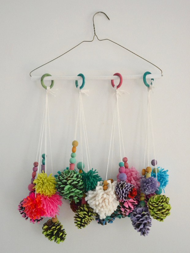 The best Autumn crafts for kids. Beautiful autumnal pine cone mobile by Art Bar