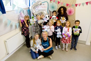 Teddy bear making party by Made By Me Craft Parties. Group of children and party hostess posing with their teddy bears and crafts