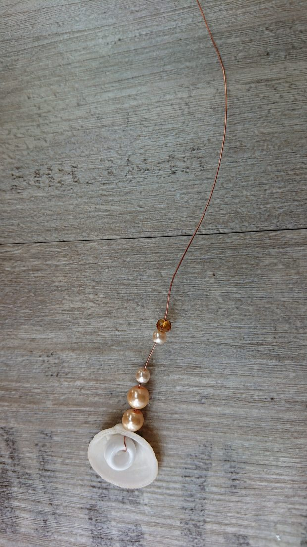 Beads being threaded onto wire