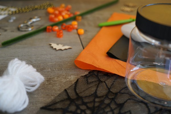 Halloween crafts - wool, plastic jar, beads, wooden shapes