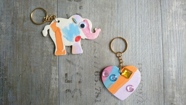 decorate your own elephant and heart keyring with gems and pens