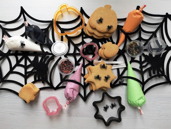 Halloween Activities for kids - picture of a Halloween themed biscuit decorating kit. Pumpkins, ghosts, cauldrons