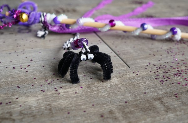 Black spider made out of a pipe cleaner