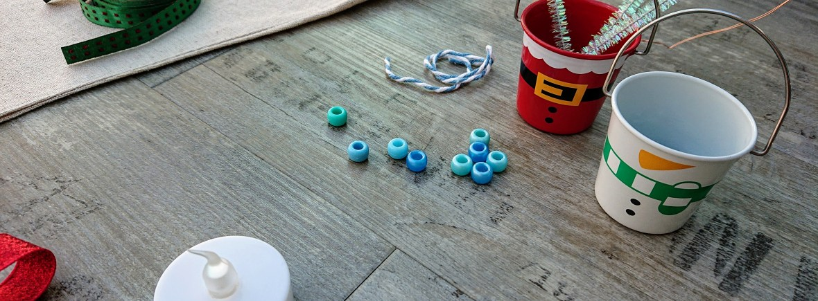 blue beads, electric tealight and sparkly pipe cleaners