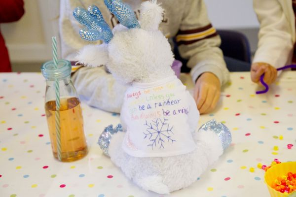 a make your own teddy t-shirt decorated with a snowflake