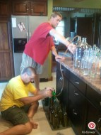 My dad and brother siphoning the wine from the fermenting bottles into wine bottles.