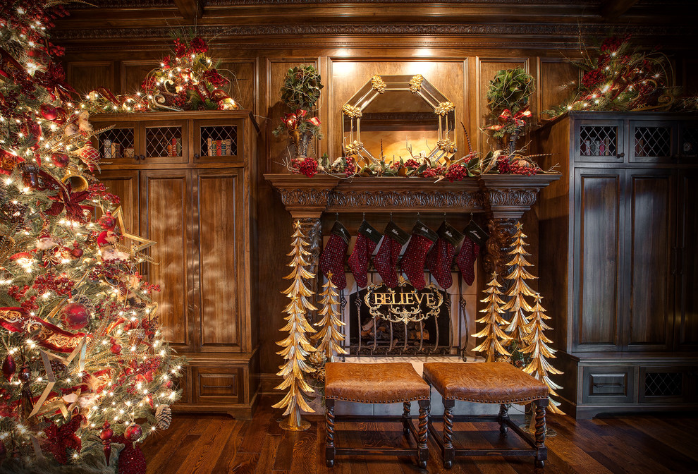 Elegant christmas stocking holders in Family Room Traditional with Diy Fireplace  next to Red And Gold  alongside Dark Wood Paneling  and Mantel Decor