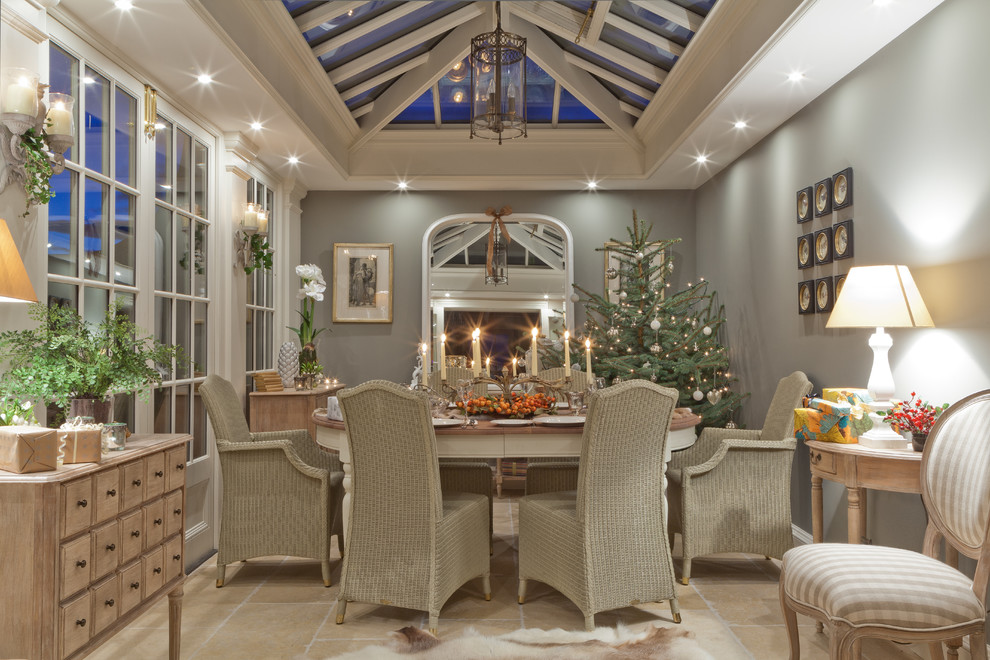 Chic lighted christmas trees in Sunroom Traditional with