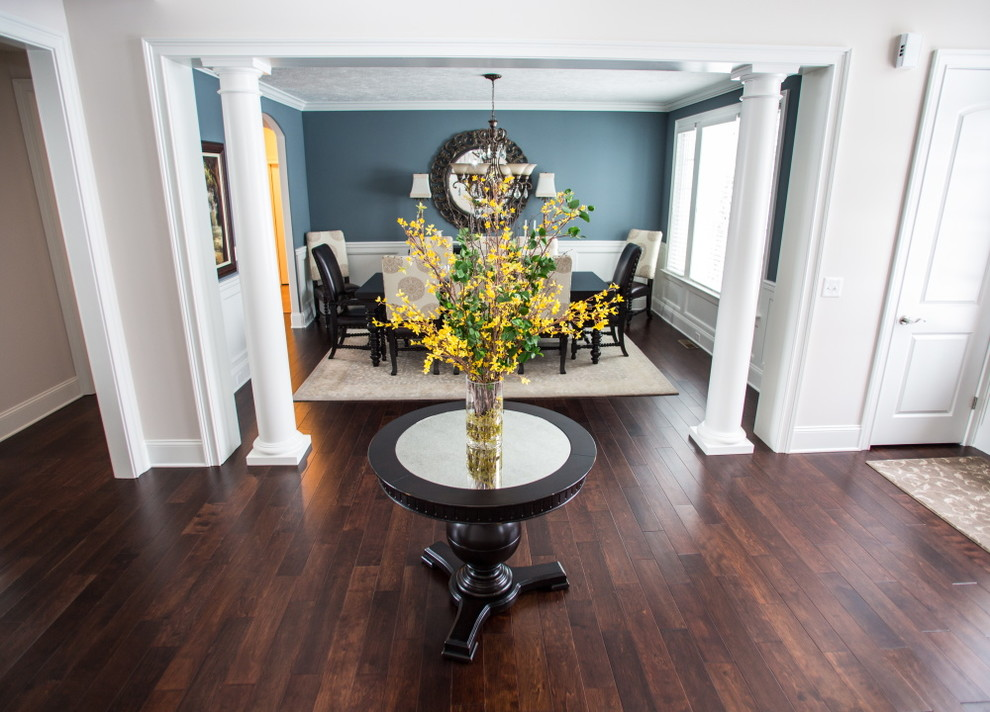 Chic round foyer table in Dining Room Transitional with