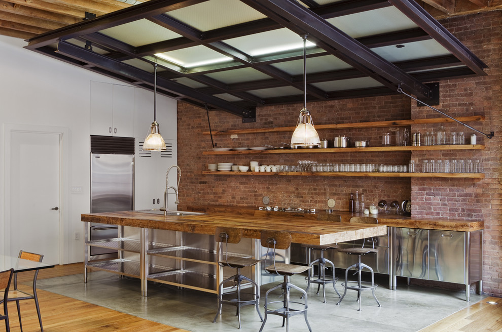 Dazzling stainless steel griddle in Kitchen Industrial with Open Shelves  next to Lighting Over Kitchen Sink  alongside Painted Brick Ideas  and Open Concept Kitchen Living Room