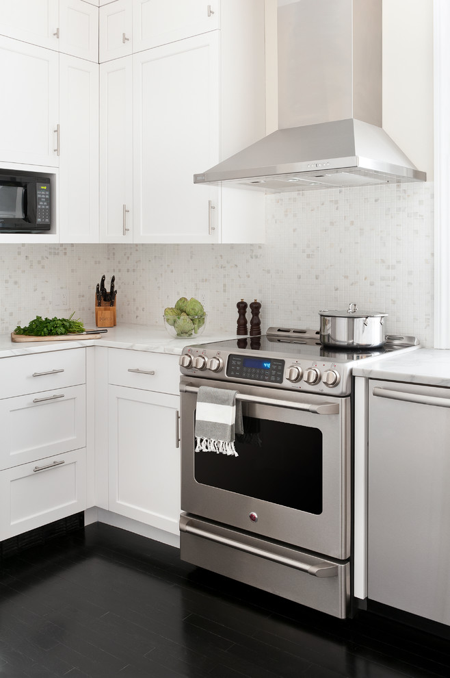 Impressive stainless steel griddle in Kitchen Transitional with Corner Gas Fireplace  next to Hiding Electric Panels  alongside Dirty Kitchen  and Backsplash
