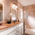 Innovative delta dryden in Bathroom Traditional with Delta Faucet next to Mosaic Mirror alongside Seagrass Limestone and Bronze Faucet
