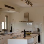 Marvelous bathroom exhaust fan with light in Kitchen Modern with Painted Glass Backsplash next to Downdraft Range Vent alongside Behind Stove Ideas and Hidden Safe