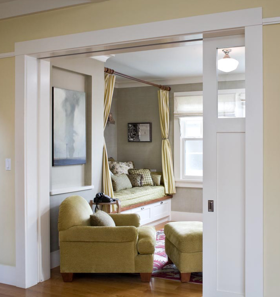 Splashy white ruffle curtains in Living Room Traditional with Painting Wood Paneling  next to Pocket Door  alongside Main Door Design  and Simple House Design
