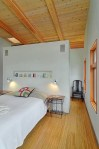 studio apartment dividers bedroom contemporary with wood ceiling nickel wall sconces