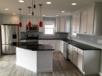 Black Quartz Countertops Kitchen Eclectic with Stone Slab Backsplash Hawaii Heating and Cooling Companies