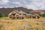 Rustic Wood Siding Exterior with Tall Grass Freestanding Birdhouses