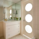 sliced pebble tile powder room contemporary with rock wall freestanding linen towers