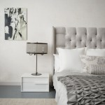 new york tufted sleigh headboard with dark wood nightstands and bedside tables bedroom contemporary white walls gray