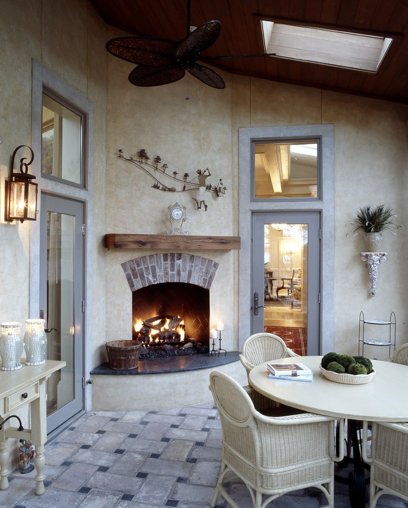 Wonderful Outdoor Stucco Fireplace with Red Brick Fence Top