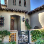 los angeles wrought iron window grills with copper outdoor wall lights and sconces entry mediterranean terra cotta