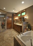 Outstanding Commercial Bathroom Design with Mirror Panelled Cabinets
