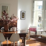 san francisco farm dining room with round side tables and end eclectic wood table magazine storage