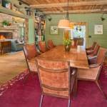 united states sage green home with industrial swing arm wall lamps dining room rustic and area rug built-iin bookshelves