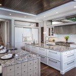 tampa kitchen island seating with beach style decorative objects and figurines contemporary dark wood panel ceiling lots of natural light