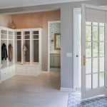 minneapolis mudroom cabinetry with beach style paintings entry and built-in storage lake home