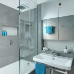 adelaide tub and shower with contemporary pendant lights bathroom mirrored medicine cabinet frameless partition
