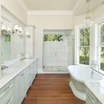 charleston bathroom linen cabinets with l listed vanity lights traditional and wood floors stand alone tub