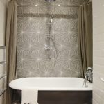 london tub and shower with metal toilet paper holders bathroom industrial roll top bath loft