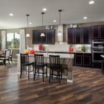 phoenix slipcovered counter stools with contemporary chandeliers kitchen transitional and granite countertop island pendant lights