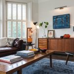 London behr brown paint Living Room Midcentury with chimney cleaners plantation shutters