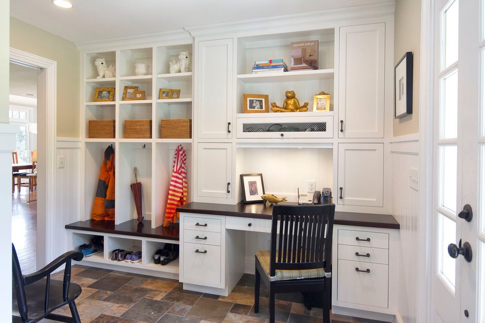 Brilliant mudroom floor ideas Traditional Laundry Room in New York with wainscoting and built-in shelving