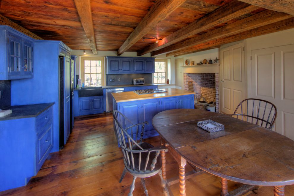 Dishy kitchen paneling Rustic Kitchen in Philadelphia with wood top island and wide plank beadboard