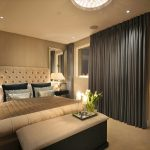 Imaginative camelback upholstered headboard in with bedroom curtains and