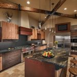 Imaginative wood vent hood Southwestern Kitchen in Phoenix with granite backsplash and gray subway tile