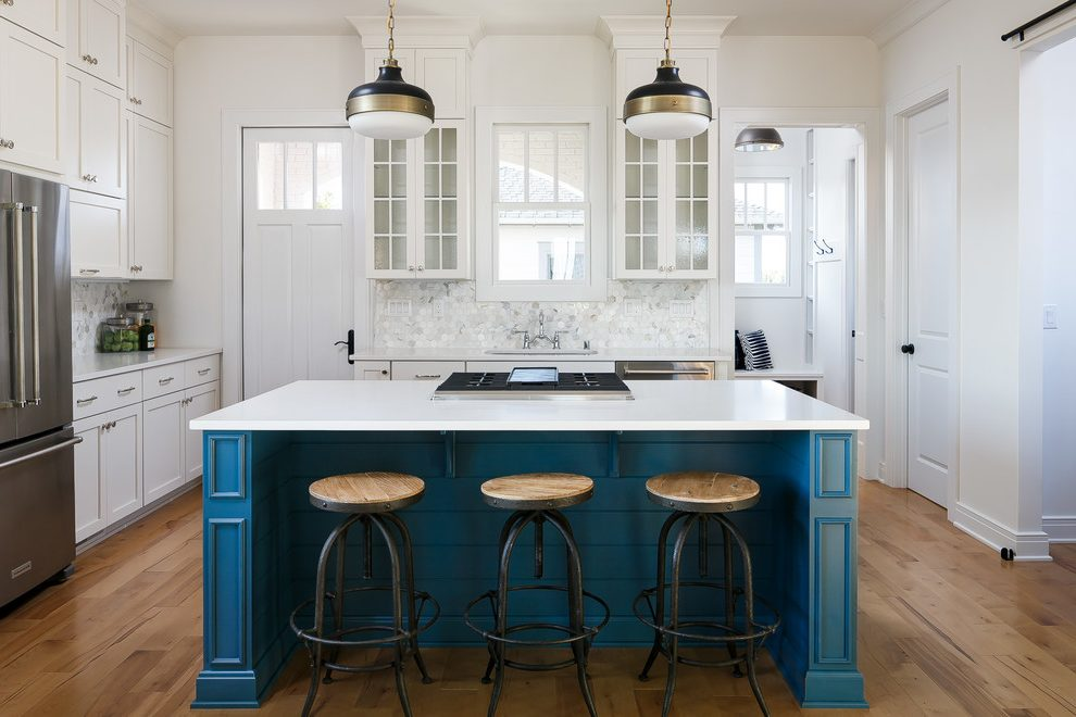 Pleasing kitchen paneling in with window above sink and decor
