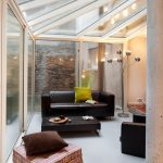 Marvelous metal and glass etagere Contemporary Sunroom in Angers with Black sofa ceiling