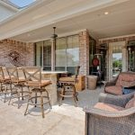 Wonderful rustic outdoor lighting Traditional Patio in Dallas with brick wall and patio furniture