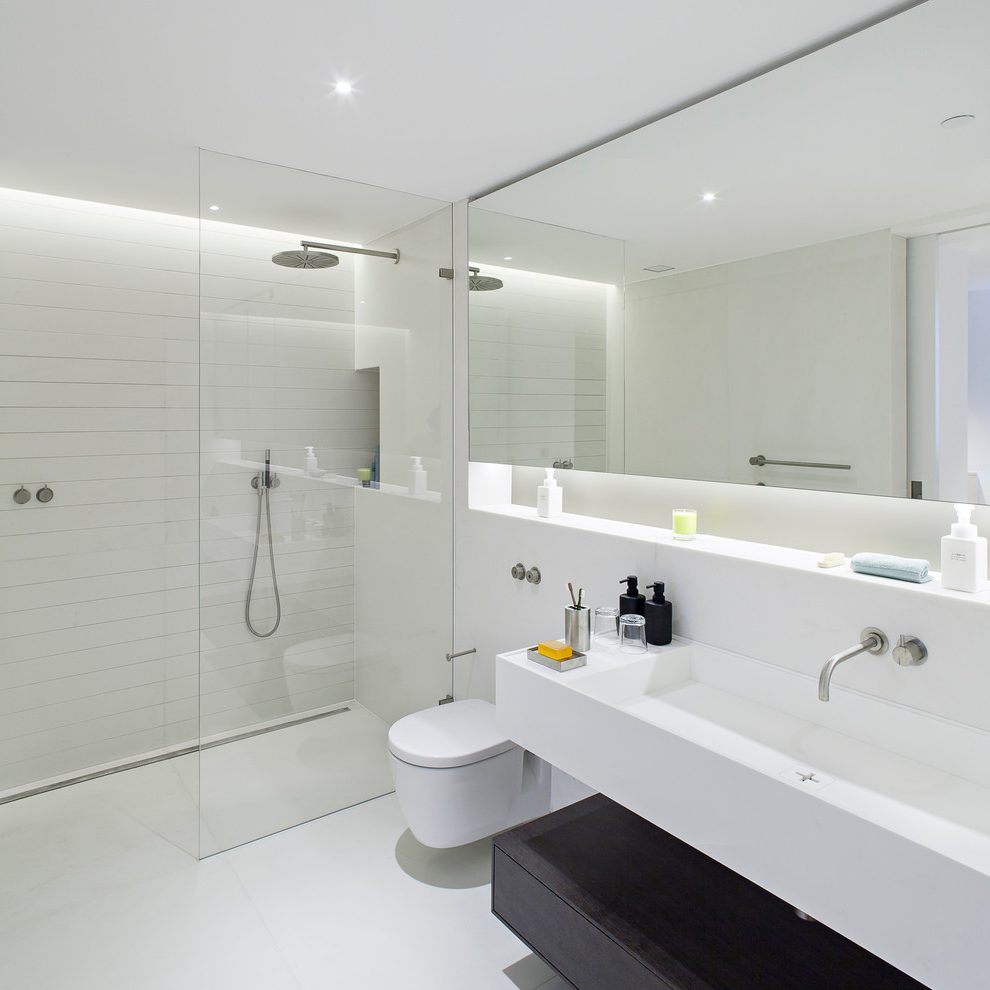 Astonishing bathroom wall design Contemporary Bathroom in London with mounted trough sink and recessed shelf