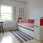 Dishy trundle bed frame in with gray curtains and red sheets