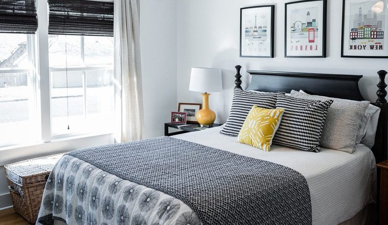Extraordinary yellow lattice curtains Transitional Bedroom in Austin with black and wicker basket