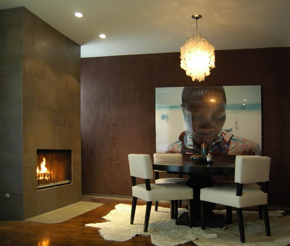 Good-looking expandable round dining table in with modern fireplace and wood flooring