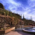 Imaginative pondless water feature Southwestern Pool in Phoenix with vanishing edge and desert landscape