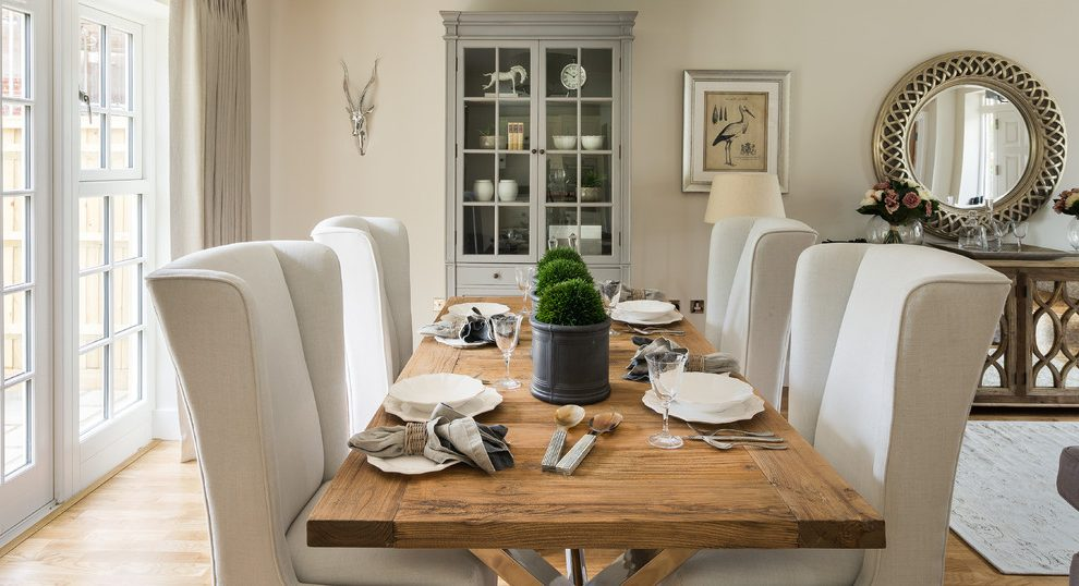 Splendid expandable round dining table Farmhouse Dining Room in Berkshire with traditional design and metal deer head