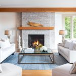 Terrific fireplace stacked stone in with Grey Upholstered Sofa and contemporary dining room