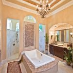 Dishy faux bois mirror Traditional Bathroom in Houston with focal wall and white trim